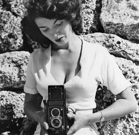 "Bunny Yeager takes one of the first recorded ""selfies."""