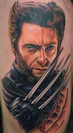 Hugh Jackman's wolverine looks fierce in this tattoo.