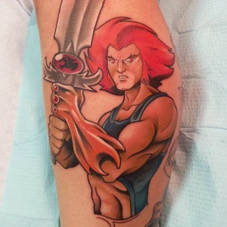 Brandon Flores is responsible for this awesomely-nostalgic Thundercats tattoo. Let's call it a Thunder-tat.