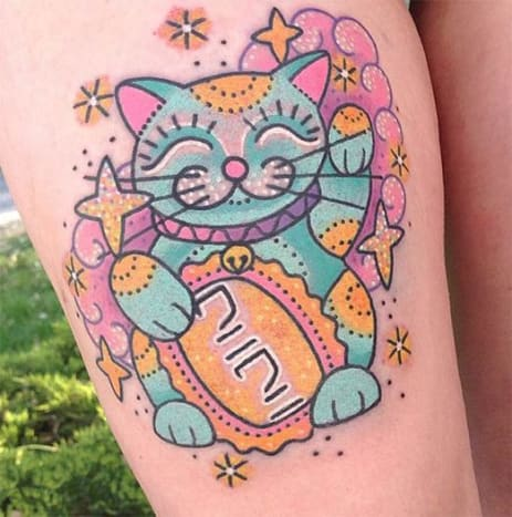 Can you even fathom anything cuter than this lucky cat tattoo by Kelly McGrath?