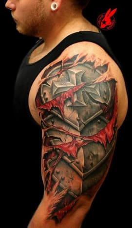 cbf0f425d Medieval armor is bursting through this man's skin in this tattoo.