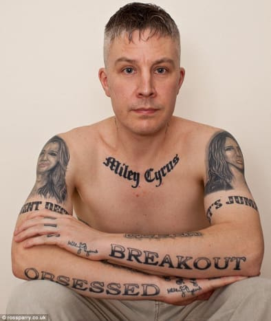 Carl McCoid, 40, takes pride in his 22 Miley Cyrus-inspired tattoos.