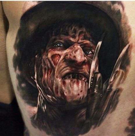Scary realistic Freddy Krueger tattoo by Mike Devries