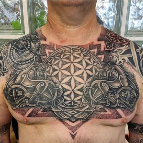 This amazing Celtic inspired chest piece was inked by Kamil Maj.