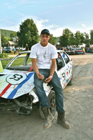 """I met Luke Hartnett at the Franklin County Fair. His dad, a mechanic and derby driver, was a major influence on him. """"I was probably eight or so when my dad brought me to my first derby,"""" he says. """"I remember getting showered with dirt and loving it.""""  After his first derby win he had his father's signature immortalized on his arm. Luke's classic ink reflects his love for his father and a huge """"demolition derby"""" logo on his bicep shows his love of racing. Luke describes his first few seconds on the track as """"an intense, nervous, adrenaline-filled rush."""" It's like getting the OK to do the complete opposite of everything you're taught to do!"""""""