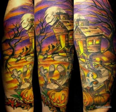 The color scheme in this tattoo is perfect for Halloween.