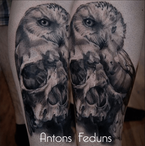 This cool owl/skull fusion tattoo was done by Anton Feduns.