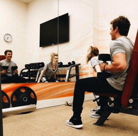 """In a photo uploaded to Gavin MacIntosh's Instagramaccount, the actor can be seen working out with girlfriend, Brooke Sorenson, and you can spot a tiny bit of ink peeking out from underneath MacIntosh's shirt sleeve. The actor captioned the photo, """"Back in town and working out with B,"""" but gave no hint as to the design of or meaning behind the tattoo, which is inked on the back of his upper left arm."""