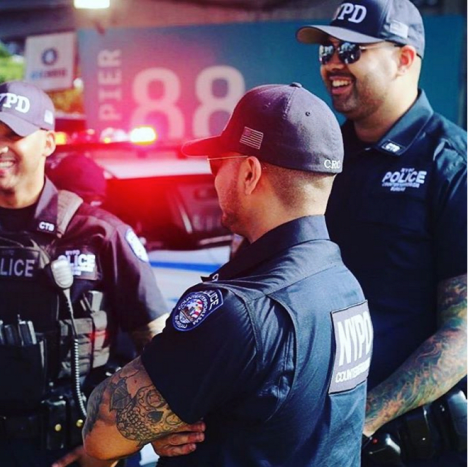 Photo: InstagramThe plaintiffs included Officer Daniel Medici, who is an Iraq War vet, and wears wings and a halo tattoo as a memorial piece to his fallen comrades, and Officers John Kukielka and Dennis Leet, who each have St. Michael tattoos, the patron saint of police. The three were in the courts last Friday (April 7) presenting arguments to convince circuit judges that a tattoo policy implemented by former police superintendent, Gary McCarthy, requiring Chicago police officers to cover up any visible tattoos while on duty – often forcing officers to wear long sleeve shirts in the dead heat of summer – was a violation of their rights.