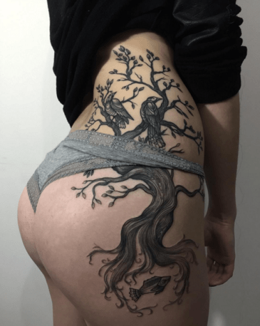 It's hard to imagine a sexier placement for this amazing tattoo by Sasha Masiuk.