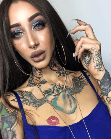 fancy girl with lots of tattoos and makeup