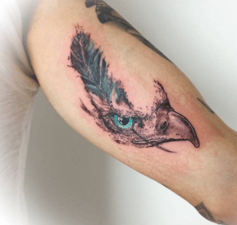 tattoo of a hawk head with feather