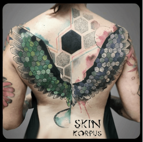 These geometric wings served as a cover up for Skin Korpus' client.