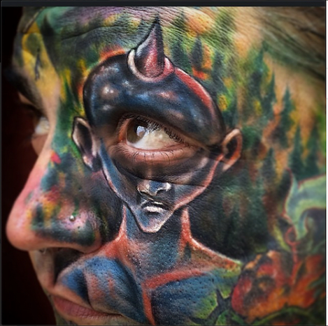 "Johnny Smith is known for tattooing elaborate color ""face sleeves."""