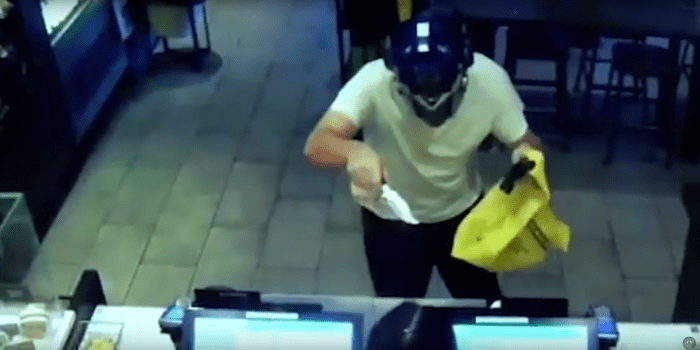 Photo via youtubeThe suspect wearing a blue Transformer's mask approaches the Starbucks counter pointing a realistic looking handgun. He holds out a bag to the young woman behind the counter and begins to wave a large knife with threatening motions. Some idiot Starbucks employee just smiles at Jerri and continues to clean the tables.