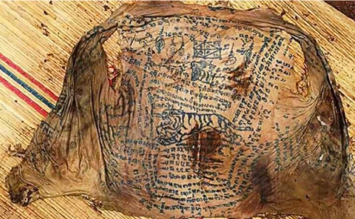Photo via Thailand PicsLocal authorities examined the skin and the markings, which consisted of Sanskrit and drawings. The artwork is suspected to have been tattooed onto the man as part of an ancient black magic spell that would keep his skin young and strong.