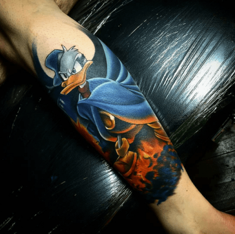Donald Duck has a badass alter ego, the Duck Avenger a.k.a. Paperinik, Phantomias, Superduck, Super Donald and Phantom Duck. Tattoo by Todd Bailey