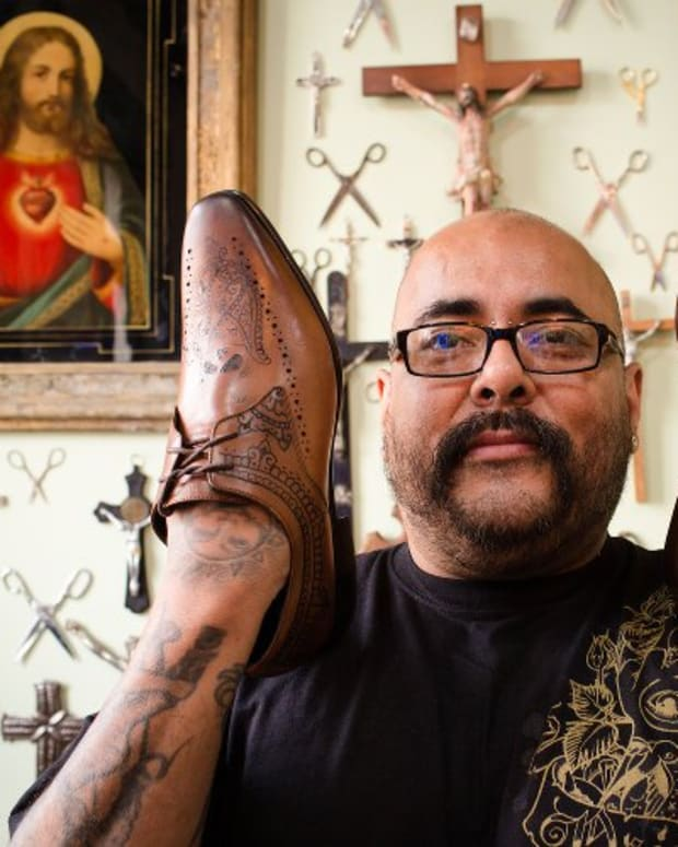 Tattoo artist Henry Hate tattooed shoes designed by Oliver Sweeney.