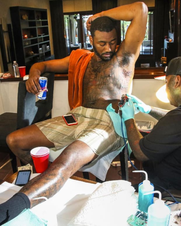 John Wall getting tattooed by Randy Harris. Photo: Instagram.