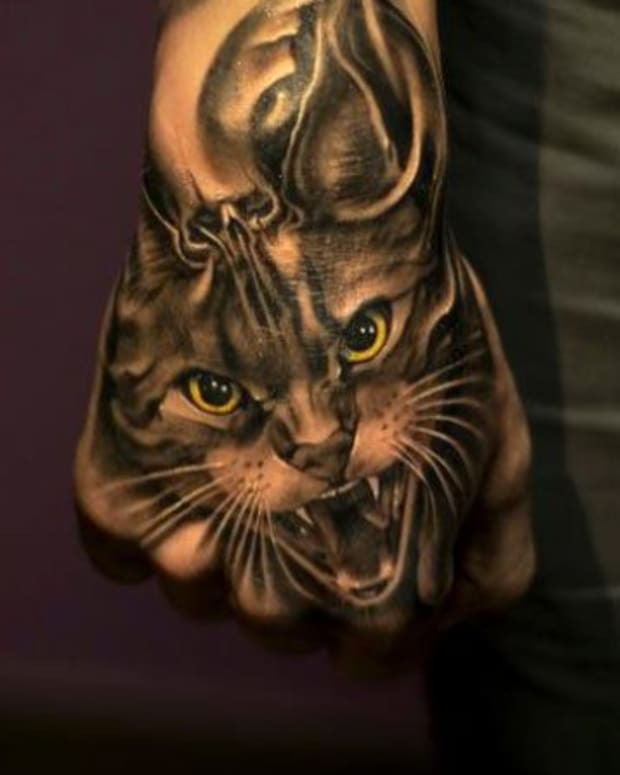 artist--Victor_Portugal-cat head hand-tattoo