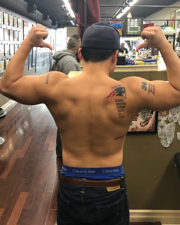 Eddie Ferrini guy who got Super Bowl Pats tattoo early