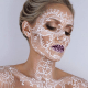 Lace played as the primary inspiration for this incredible makeup look.