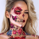 This floral creation incorporates temporary tattoos to create one stunning skull look.