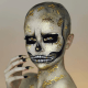 Loving the touches of gold leaf to this haunting skull makeup.