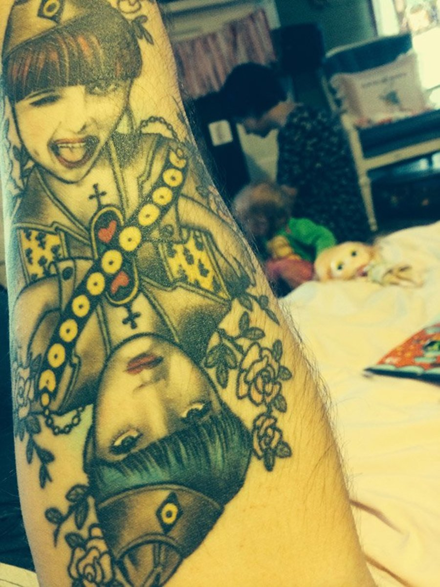 Bemis' forearm tattoo of his wife.
