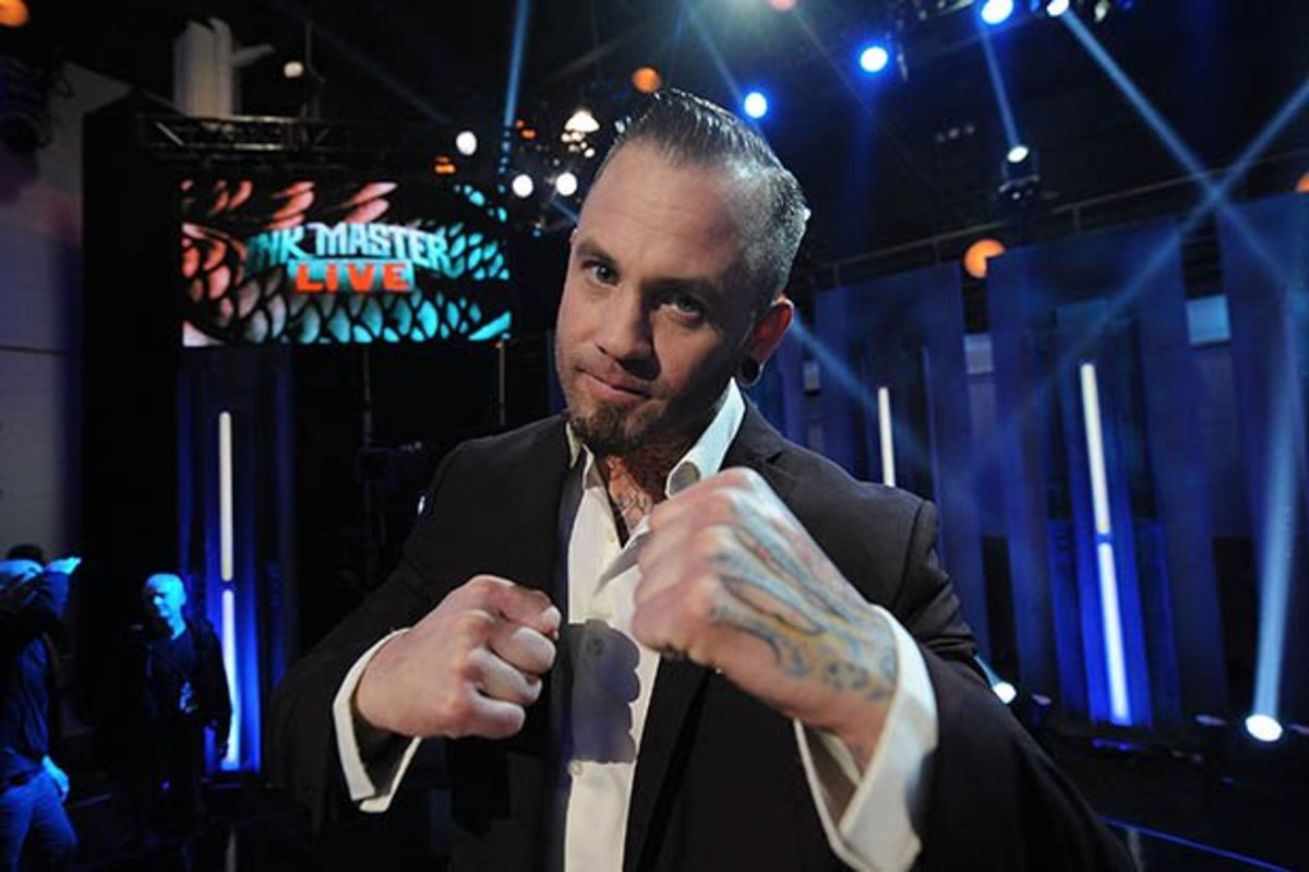 """Chicago's Scott Marshall poses for the cameras at the """"Ink Master"""" finale."""