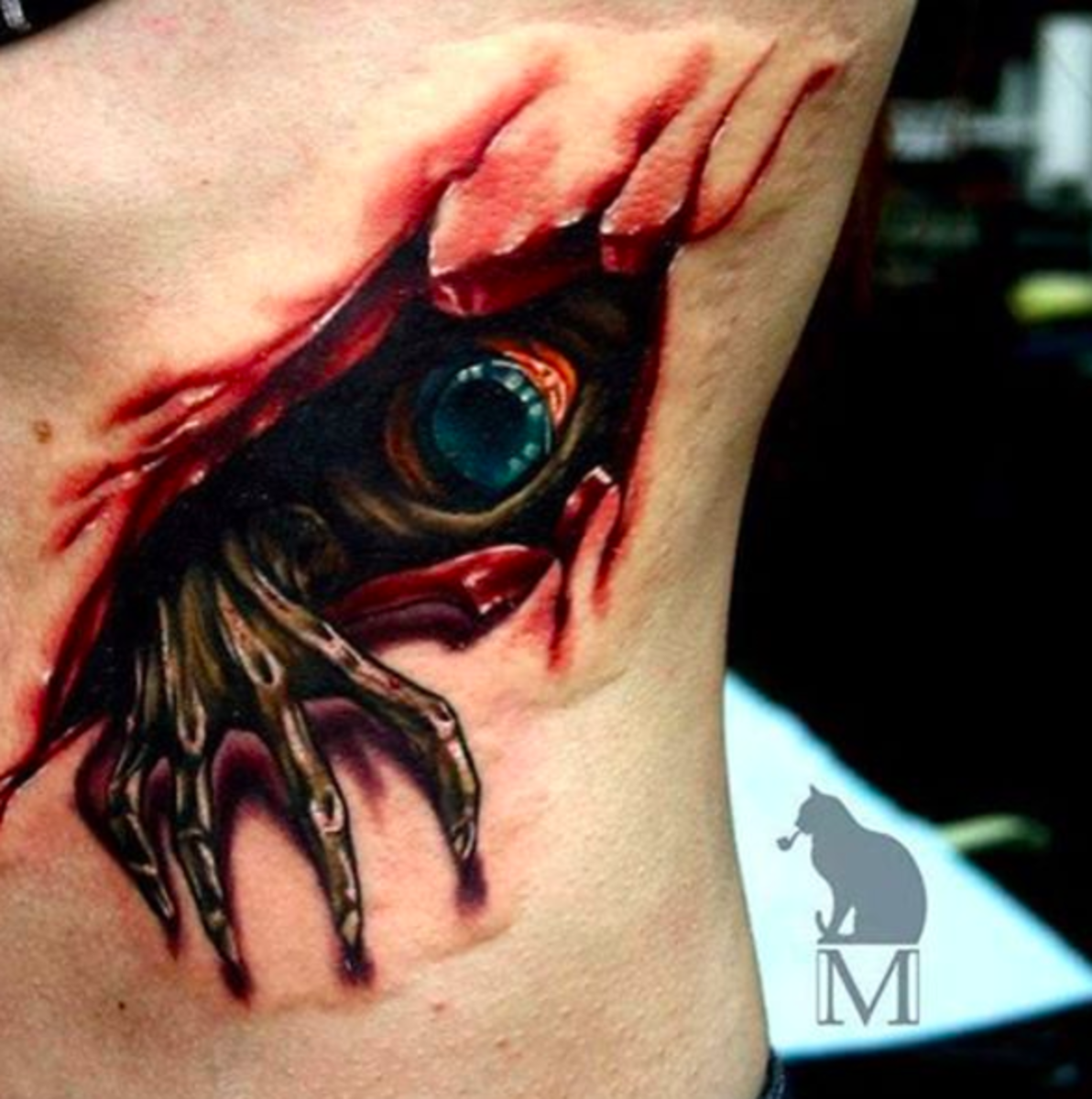 horror tatto with eye and hadn coming out