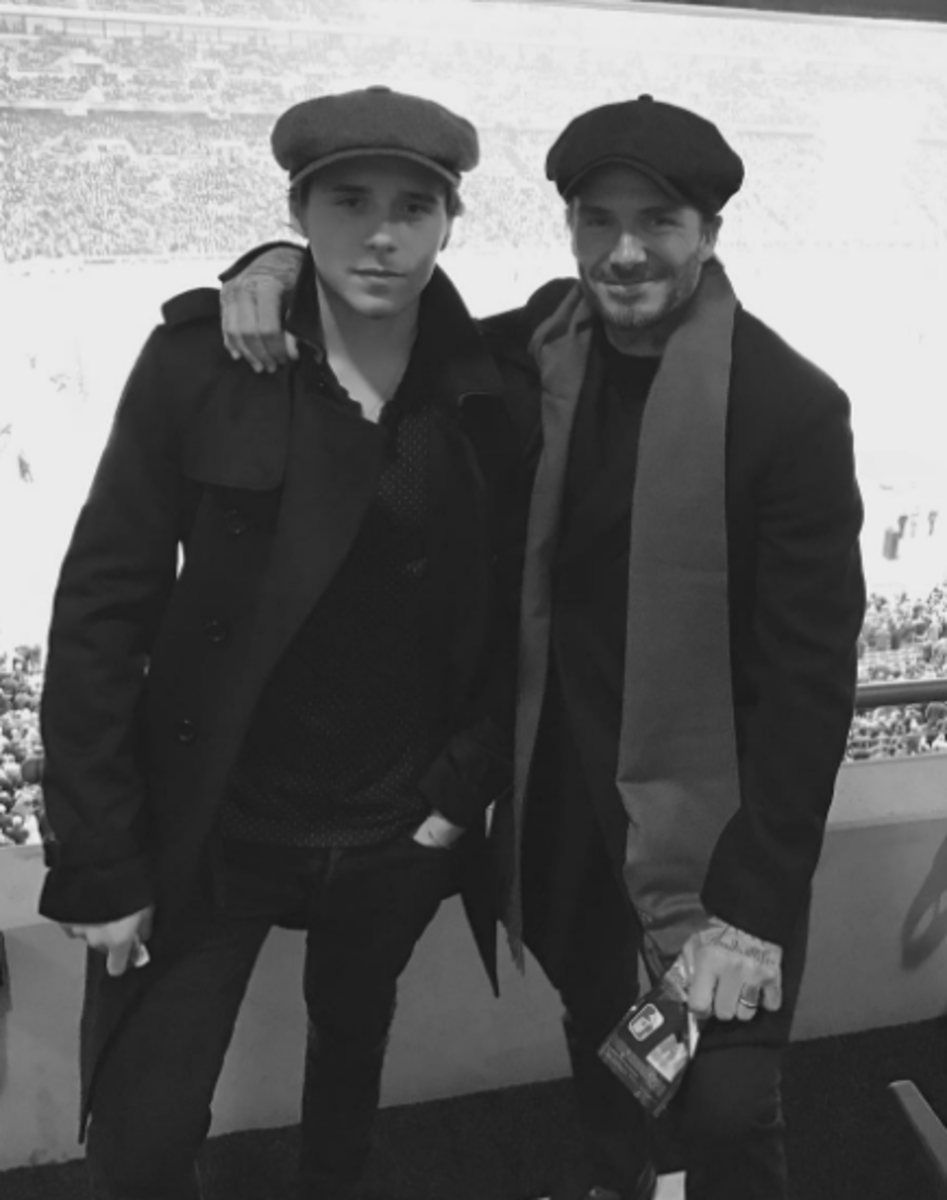 Brooklyn and David Beckham pose for a photo during posted online. Photo: Instagram.