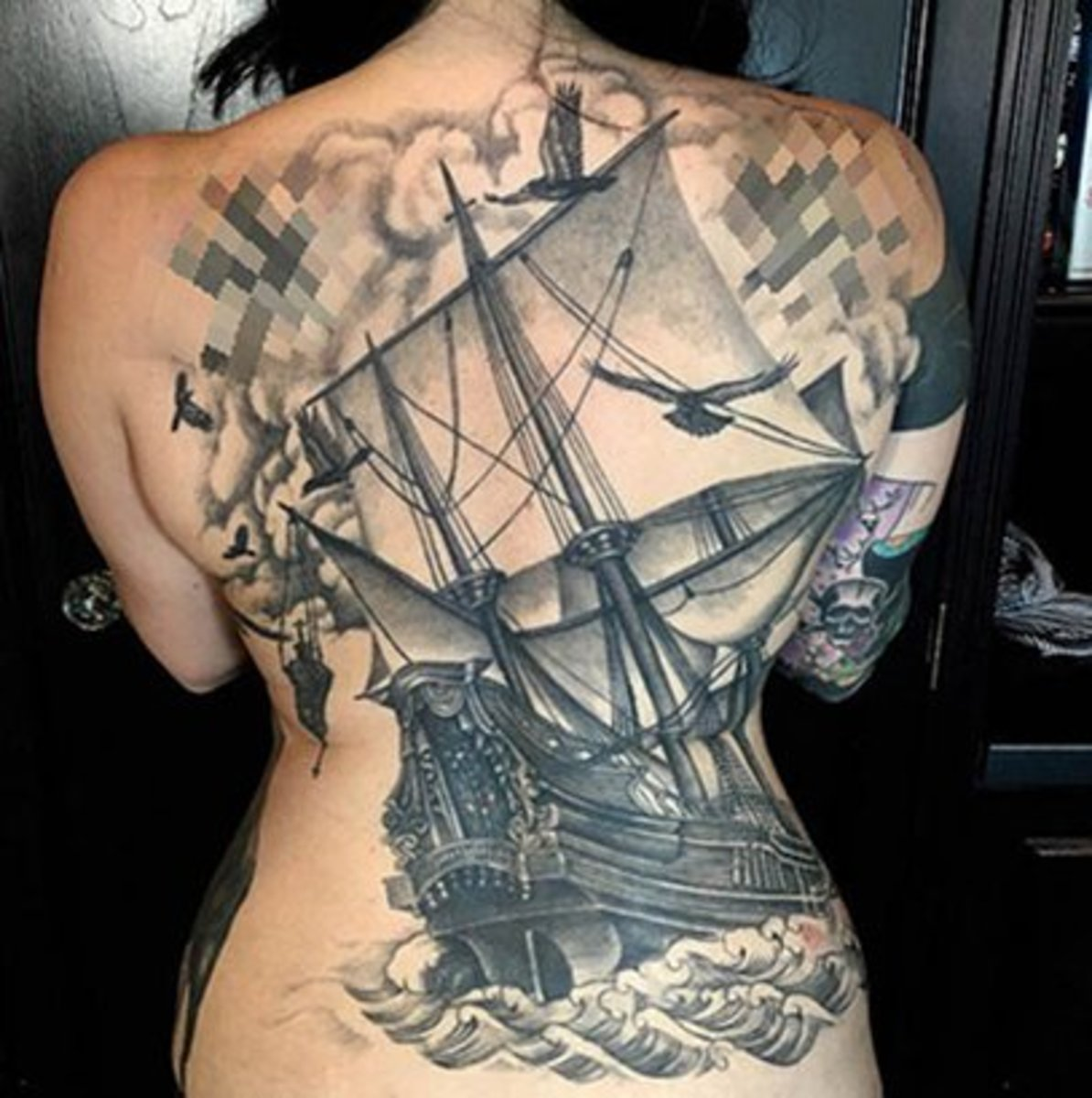 7 Stunning Black Back Tattoo Designs For Women Tattoo Ideas Artists And Models