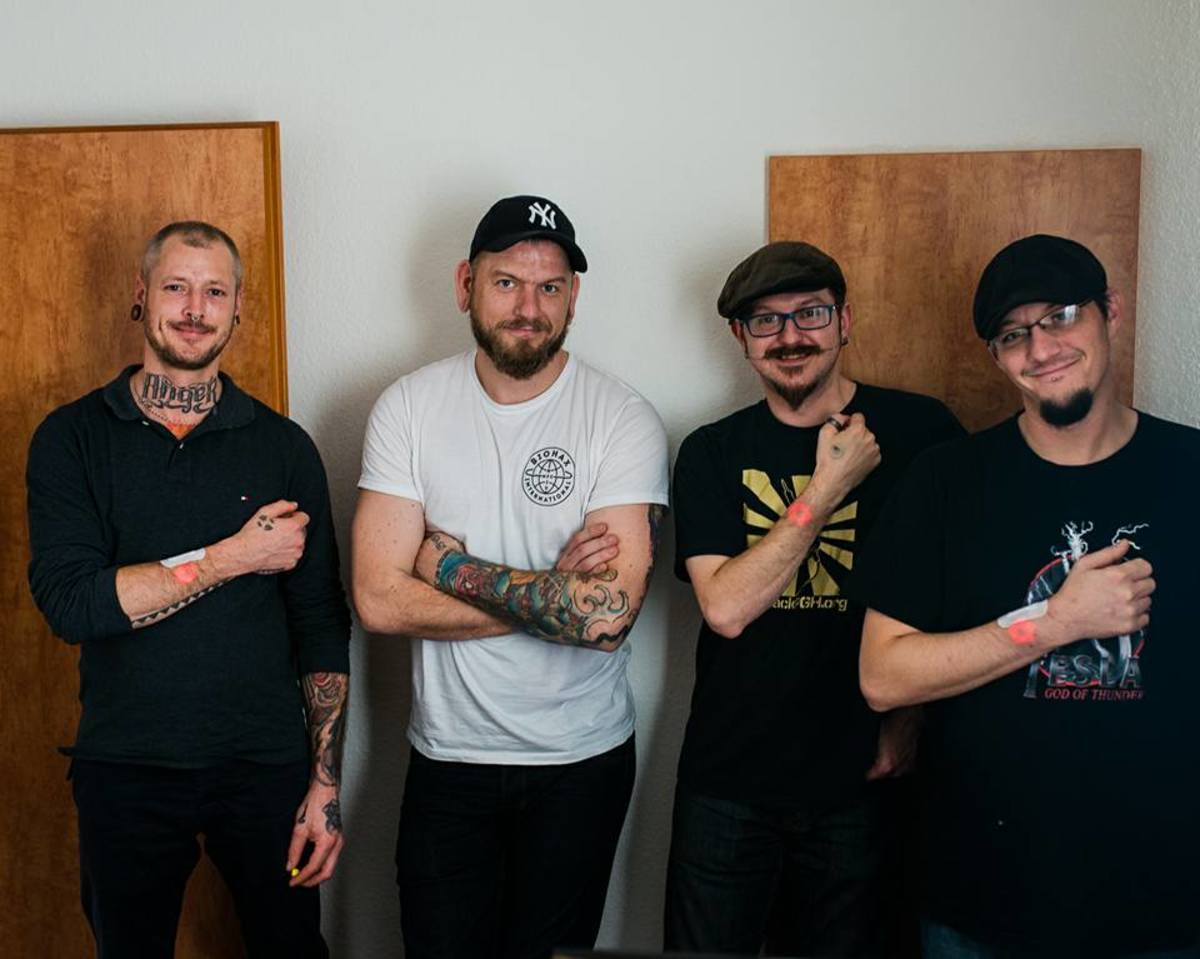 Tattooist Jowan Österlund (second from the left) and the Grindhouse Wetware team. Photo by Hannes Wiedemann.
