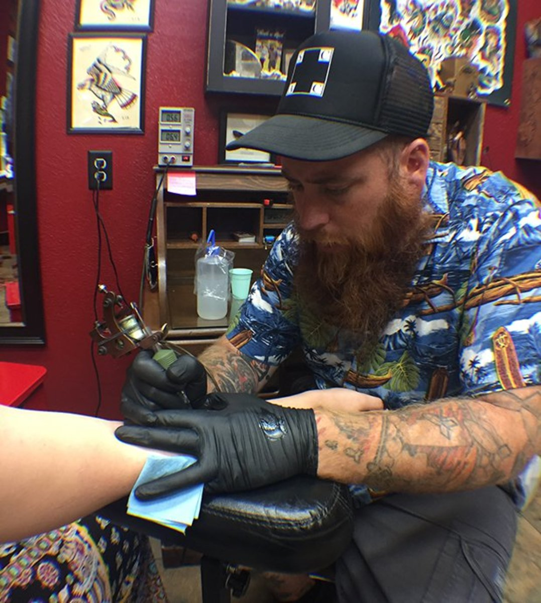 "James Wells hard at work tattooing a ""Roseburg Strong"" piece."