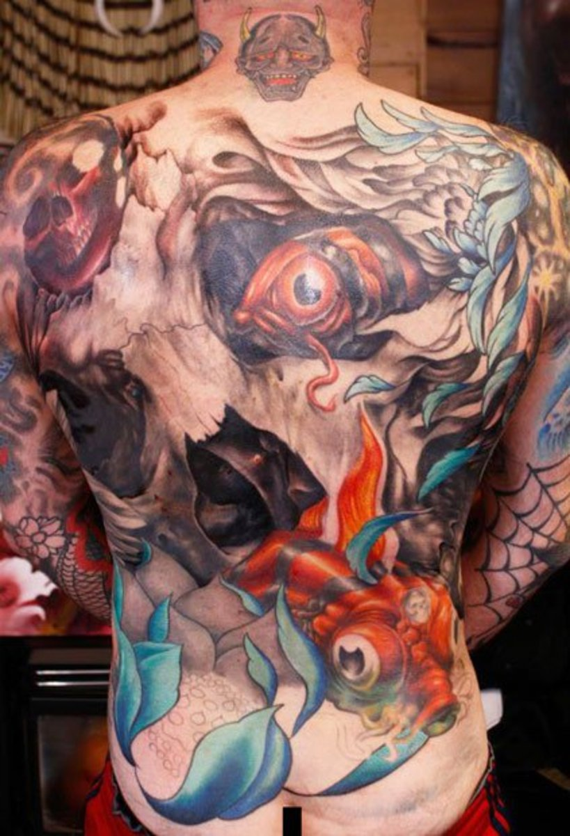 bad3f76f057a2 artist--andrew_swarbrick--skull-with-fish-back -piece-tattoo_0171374529542.jpg