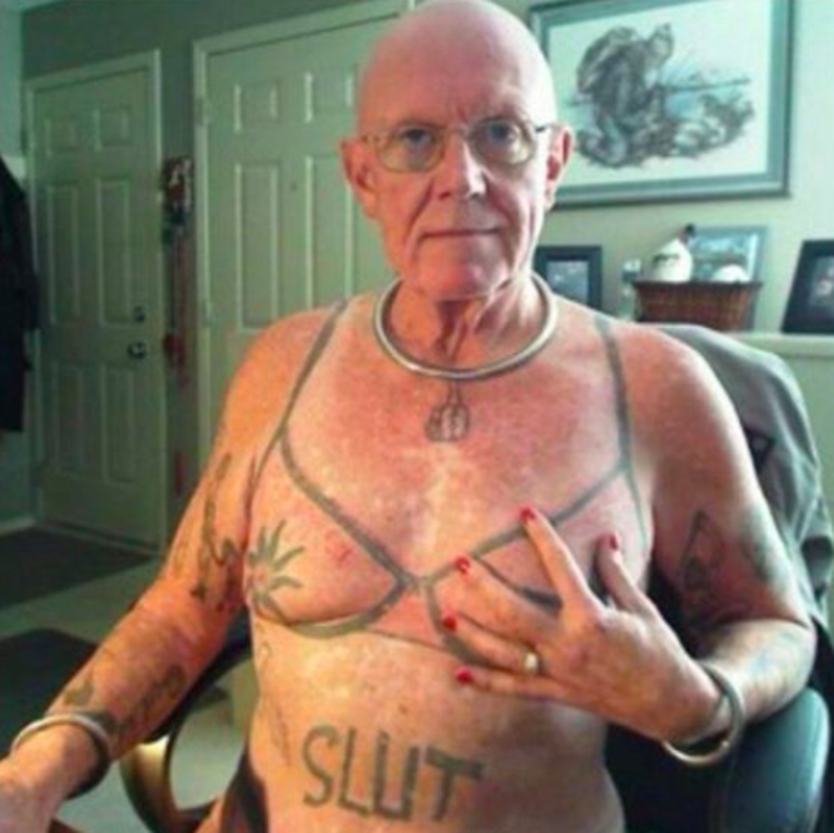 old man with bra tattoo