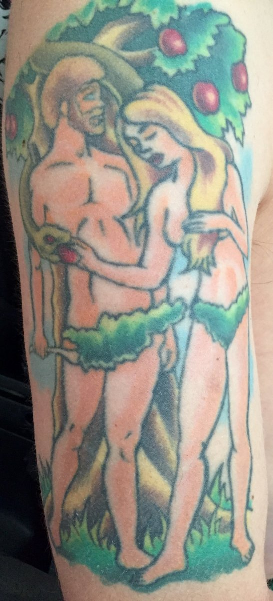 Oxley told Inked his tattoos are often faith-based. Above is his tattoo of Adam and Eve.