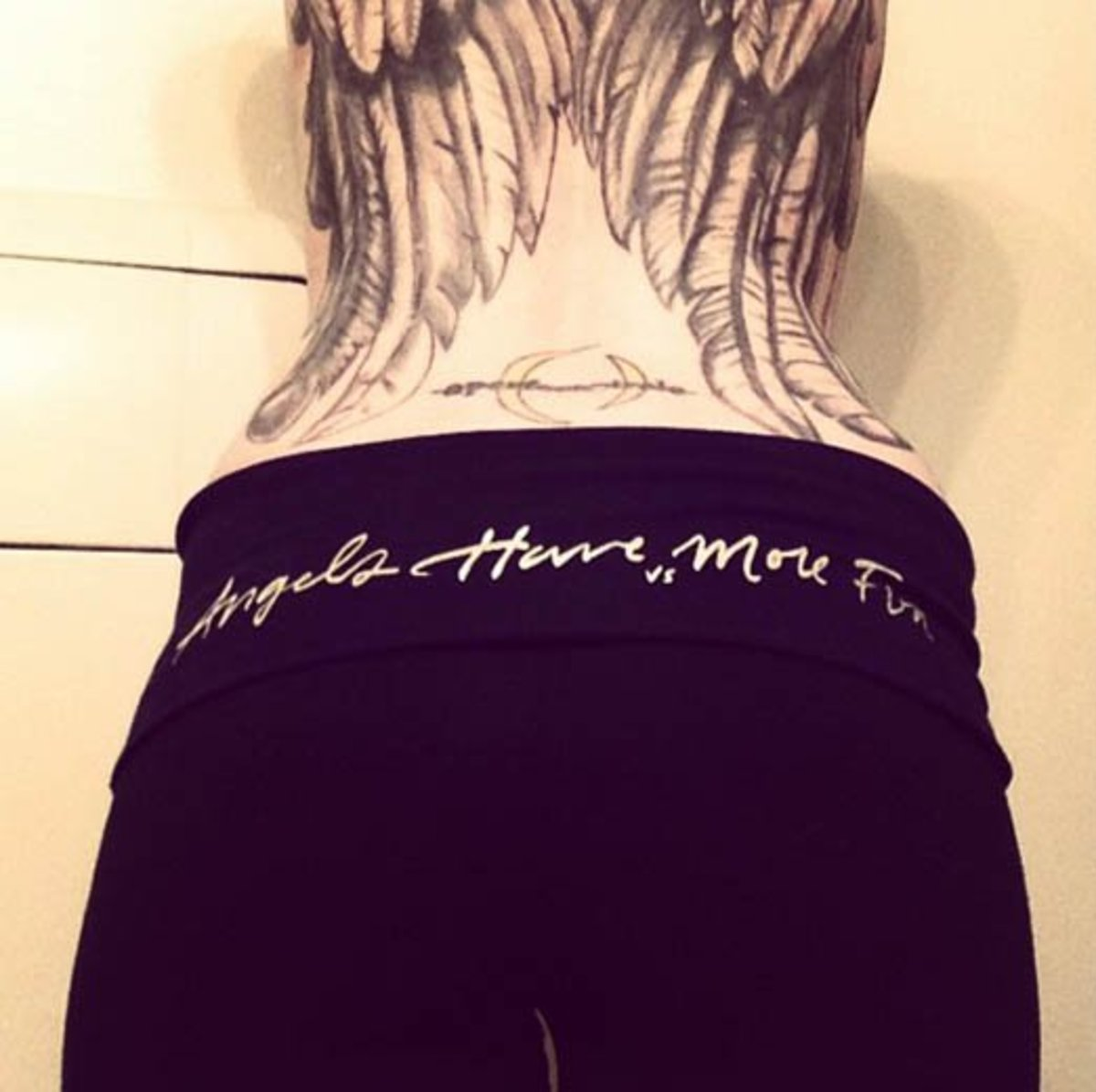 Drave Suicide and her lower back tattoo