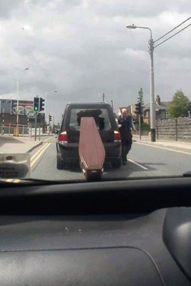 coffin falls out of car