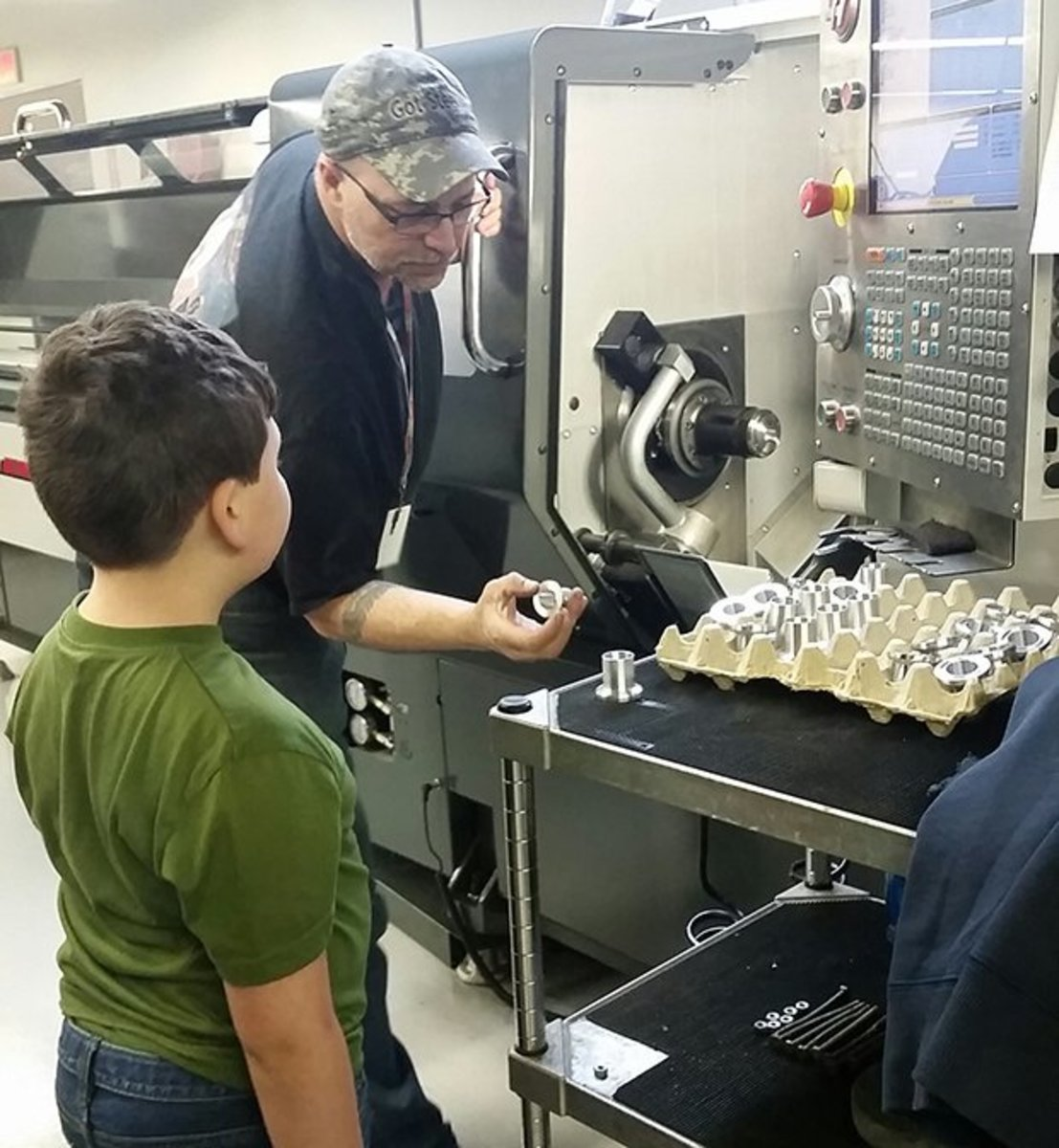Kyle's son David on a tour of the Borg Design plant in Massachusetts.