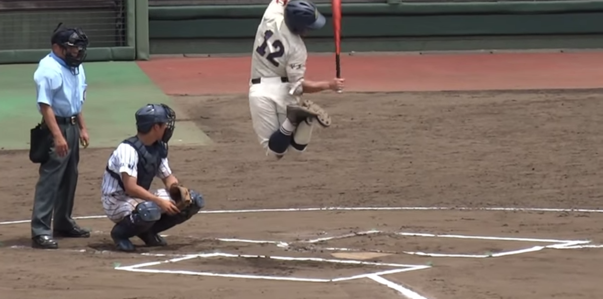 Baseball player jumping in the air