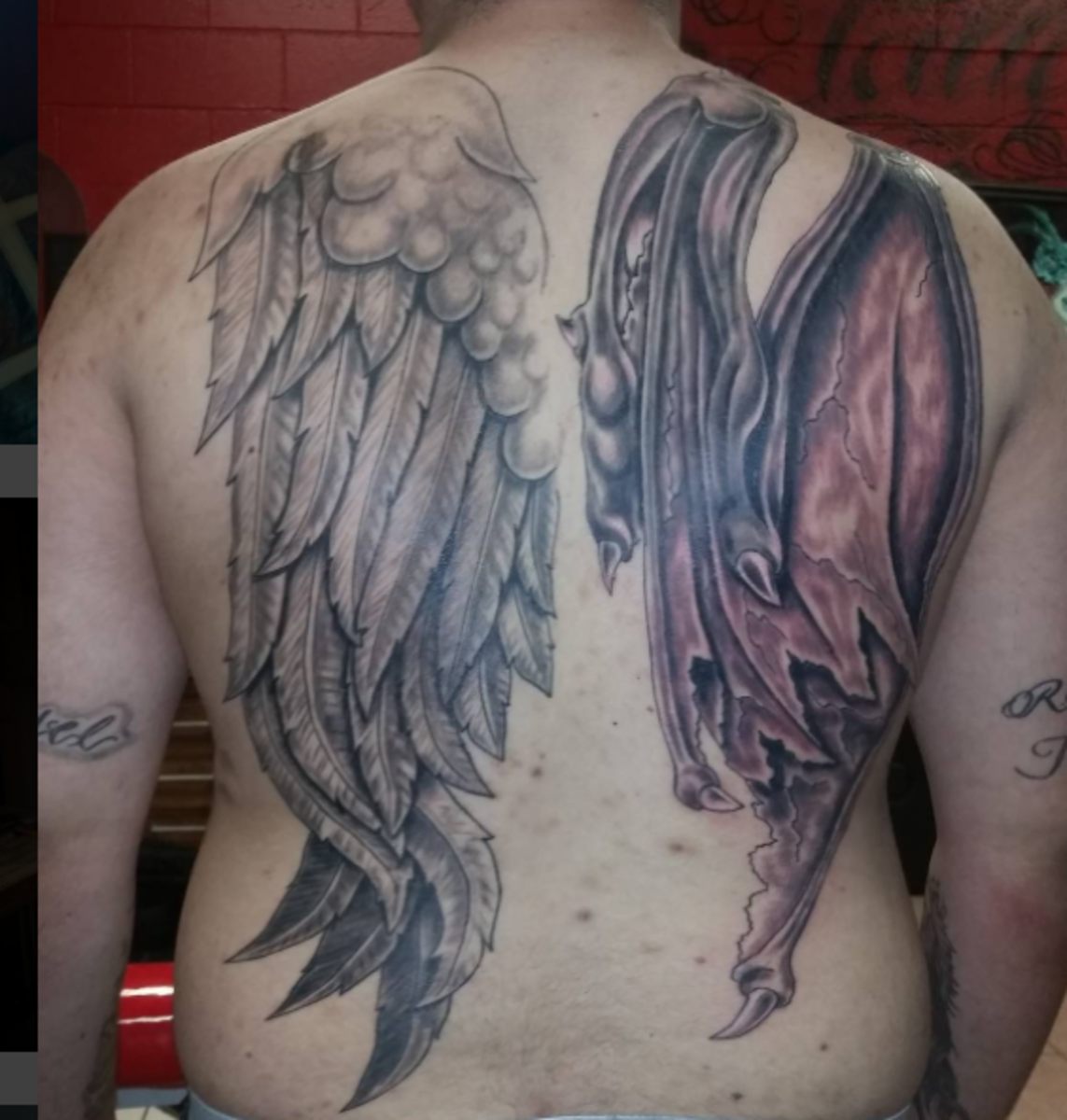 two wing tattoos on back good and evil