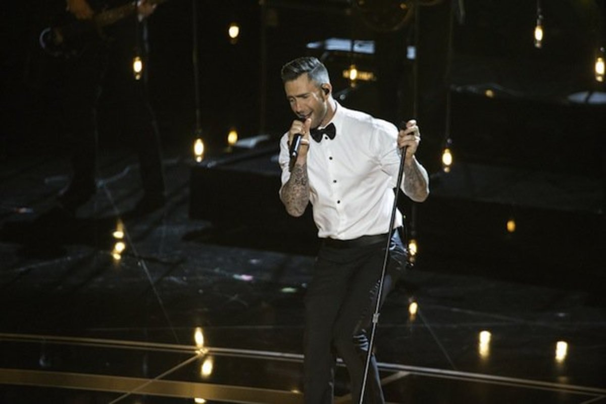 Adam Levine performing at the 87th Academy Awards