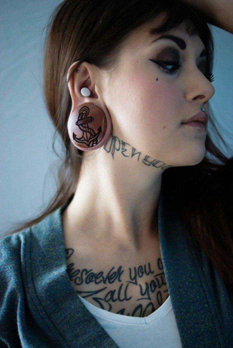 Cute-Girl-With-Tattoos-Under-Neck-and-Ear-Piercing