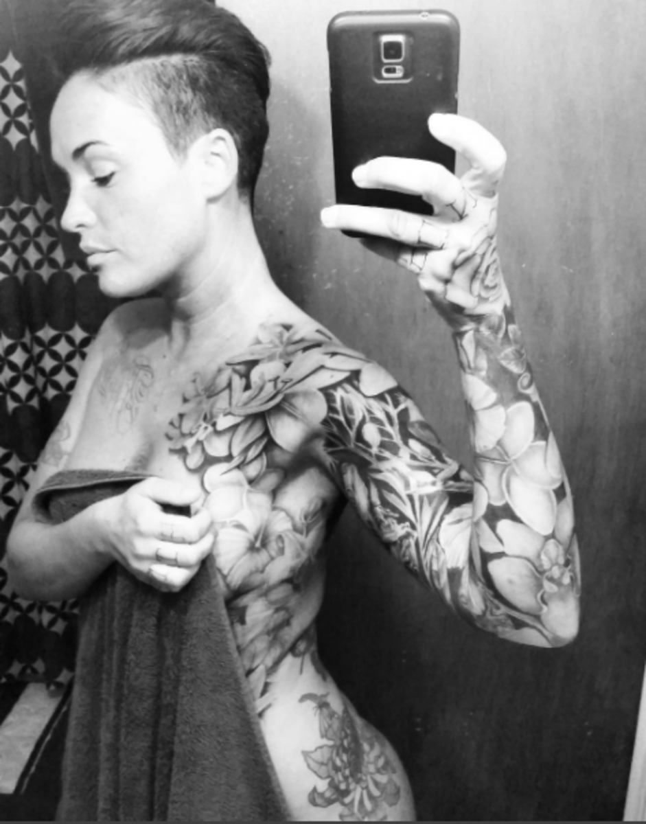 black and white photo of girl in towel with side tattoos