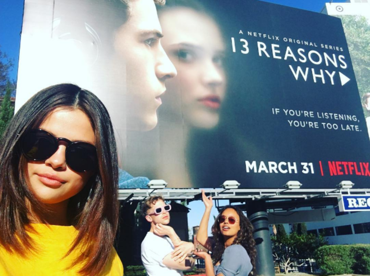 Selena Gomez snaps a selfie in front of a '13 Reasons Why' billboard along with the show's co-stars, Tommy Dorman and Alisha Boe. Photo: Instagram.