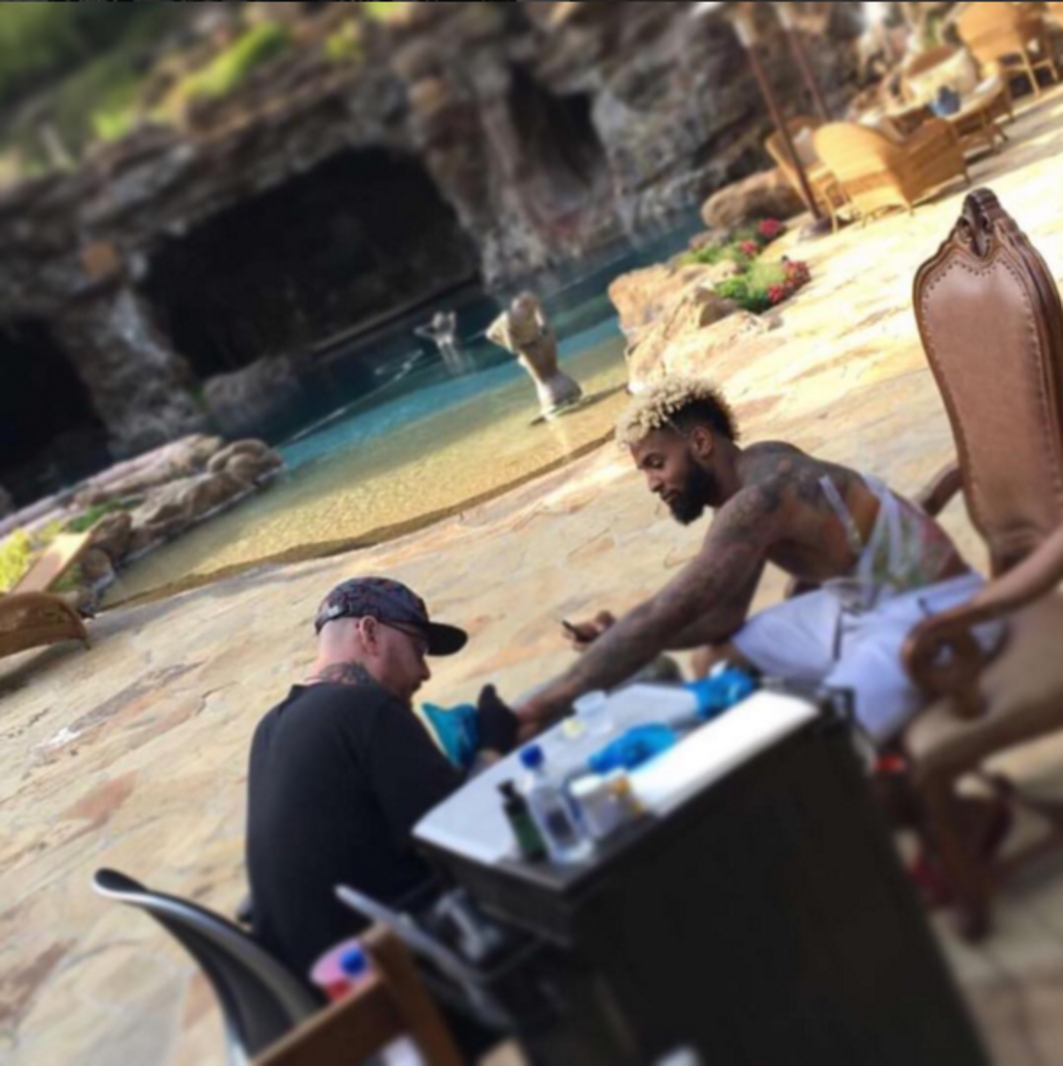 Bang Bang working on a second tattoo for Beckham.