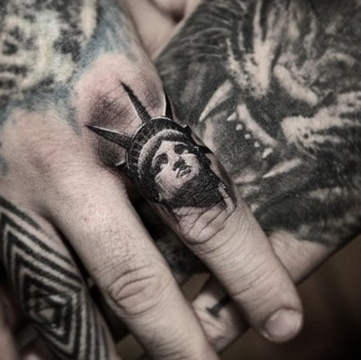 Statue-of-Liberty-finger-tattoo-Stefanos-Tattoos-Gallery-Pain-Magazine