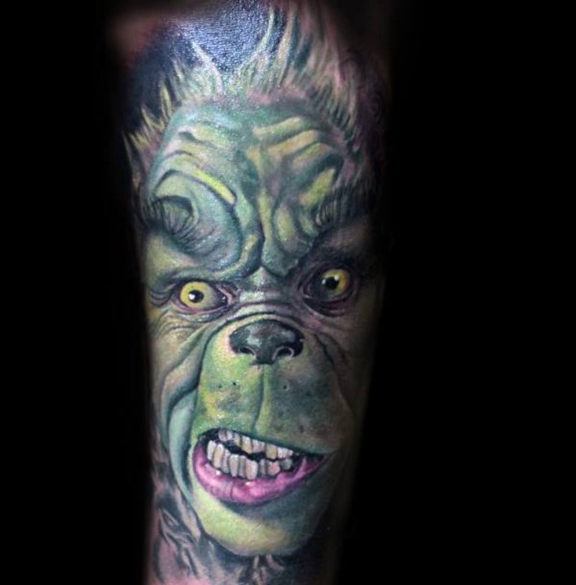 male-with-cool-grinch-tattoo-sleeve-design